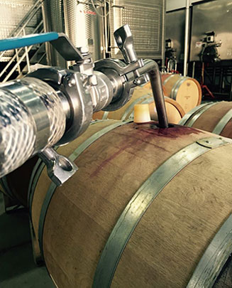 Wine barrel being filled.