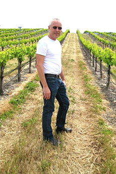 Larry Brooks of Smith Family Wines in grapefield