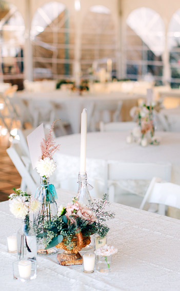 Table centerpiece with candles and flowers.